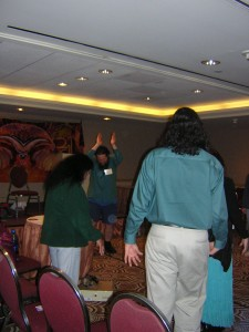 """When the world heaves up, time to dance."" The ""Hogue"" leading Kundalini Meditation (conjuring orbs) at the Conscious Life Expo, LAX Hilton, Feb. 2009. Come meditate with me this coming 14 February, same ""Bat"" Bardo time, same ""Bat"" Bardo station."